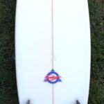 Surfboard Hire White Surfboard With Colourful Decals And Black Fins