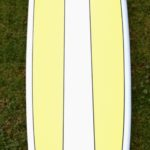 Surfboard Hire Mulitcoloured Surfboard With White Strip Down The Middle