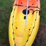 Kayak Hire Orange And Yellow Kayak On The Grass